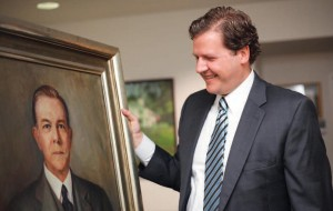 President Reveley examines the recently found portrait of his great-grandfather Thomas Eason, who taught biology at Longwood.