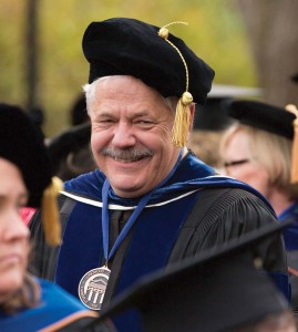 Dr. Robert Webber savors a well-deserved rest after reading 20,000 graduates' names during his 20 years as the voice of Longwood commencement.
