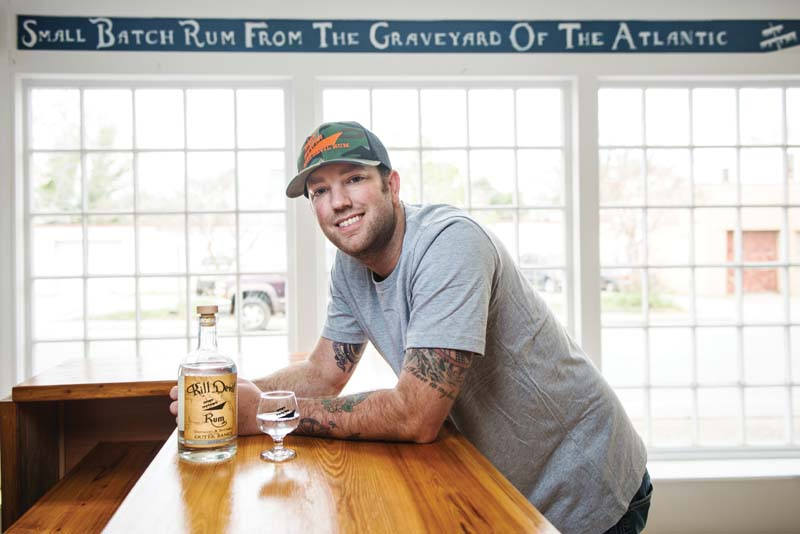 Scott Smith '05 and three friends recently opened the first 'legal' rum distillery in the Outer Banks. Photo by Daniel Pullen.