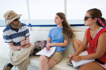 Left: Geography professor Dr. Ed Kinman of the SOLSTICE faculty, Clarissa Miller '15 (center) and Kaitlin Owens '16 discuss their SOLSTICE experiences on the way to Tangier Island.