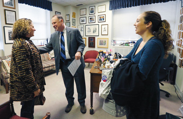 Erica Hilscher Garvey '08 (right) and her mother, Beth Hilscher, meet with state Sen. R. Creigh Deeds in his office, as part of their annual lobbying efforts for improved mental health services.