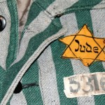 A green and grey striped shirt featuring a yellow star worn by a jewish prisoner