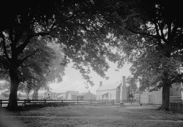 A view of the work yard featuring one of the original slave dwellings at Bacon's Castle in Surry County. Courtesy Library of Congress.