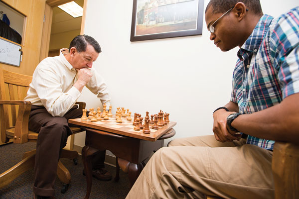 Physics professor and former Cook-Cole College of Arts and Sciences Dean Chuck Ross considers an opening move against senior history major Alex Morton.