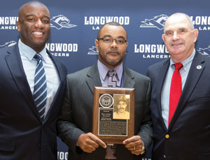 Director of Athletics Troy Austin (left) with Kelvin Davis '88 and former baseball head coach Buddy Bolding.