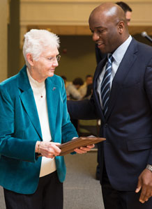 Former women's basketball head coach Shirley Duncan with Austin.