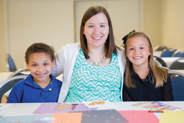 Brittany Perkins '15 balances her Longwood studies with her duties as a youth pastor at Glenn Memorial Baptist Church in Prospect. RyenToney and Emily Kelley are among the children she works with at the church.