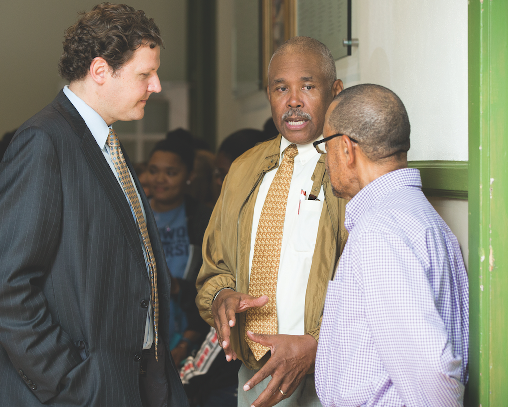 President W. Taylor Reveley IV talks with Everett Berryman Jr. (center) and Farmville Vice Mayor Chuckie Reid (right) during the opening reception for the exhibition Their Voices at the Moton Museum in April.
