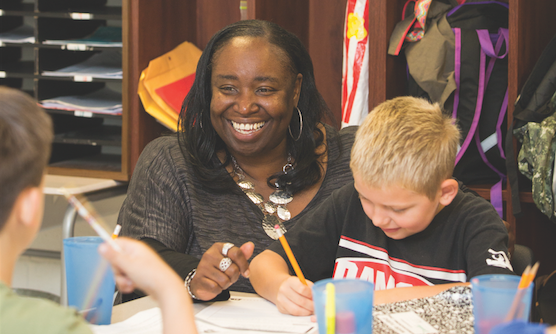 Natasha Haskins '06 and Donald Tyree enjoy a classroom lesson.