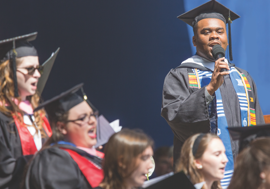 Steven J. Brown '16, a music major from Java, was part of the choral group that performed 'The Road Home' during the ceremony.