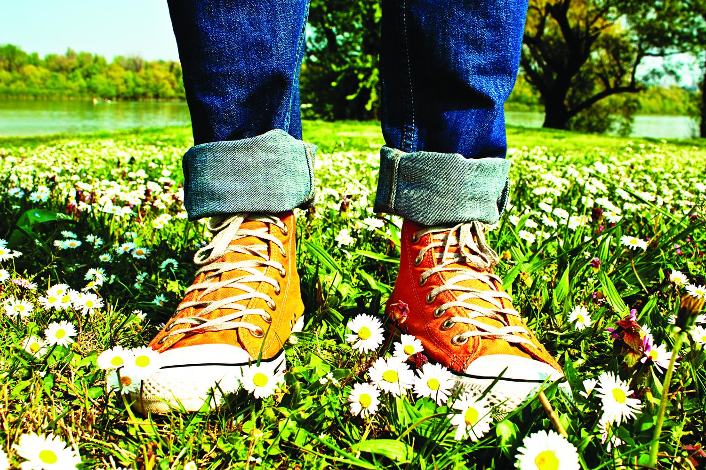 Feet in Sneakers standing in a grassy field